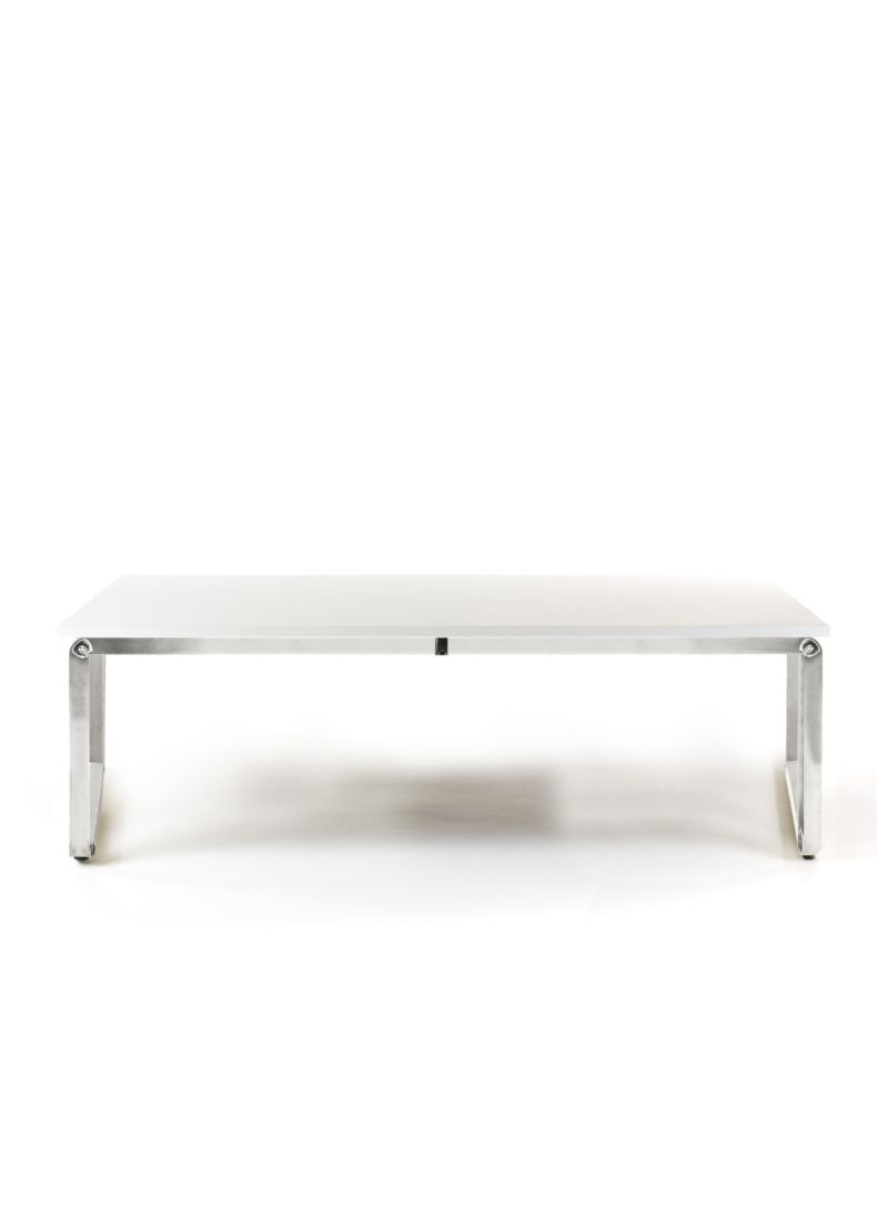 low table made in chrome steel and wooden desk